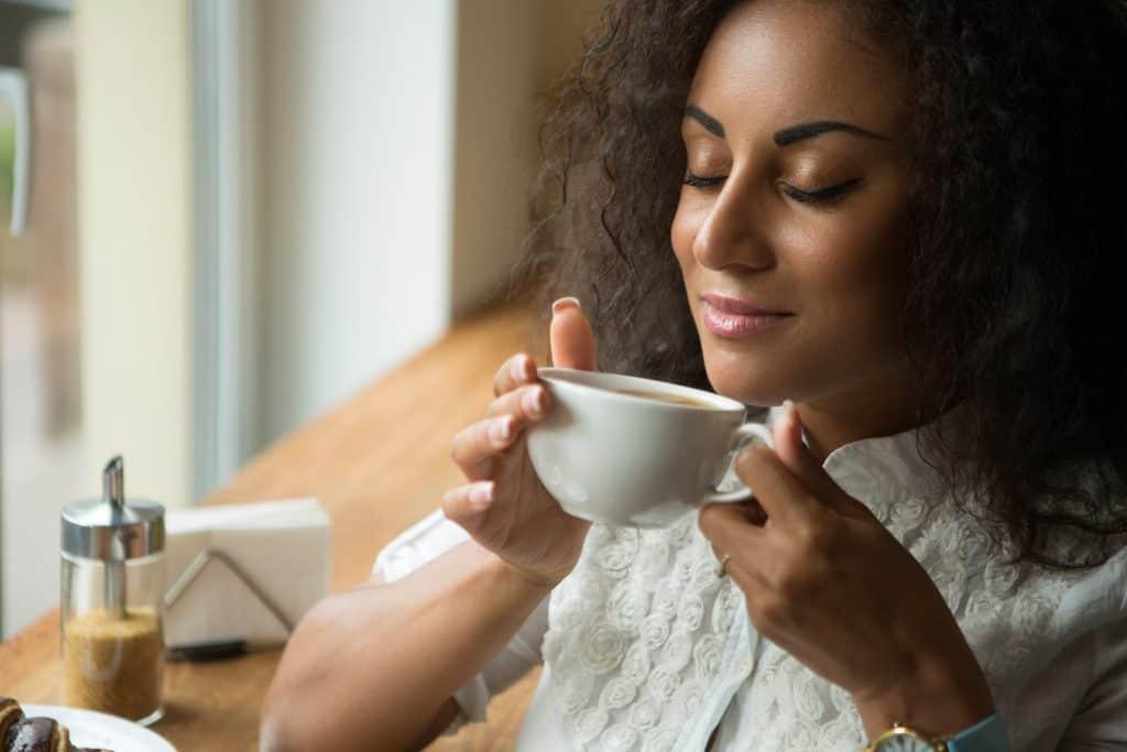 women smelling coffee